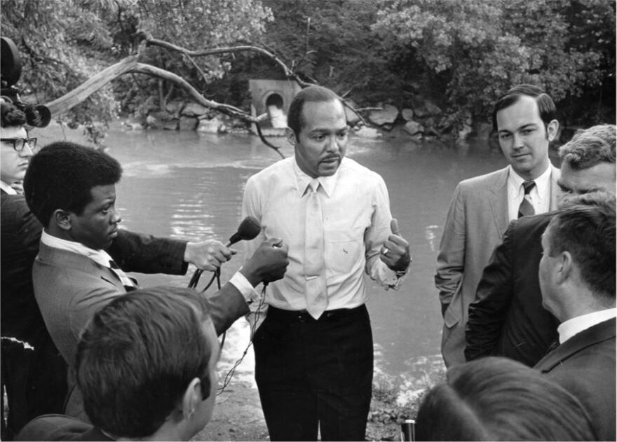 This photo of Mayor Carl Stokes holding a press conference on the banks of the Cuyahoga River after the 1969 fire was featured in Time.