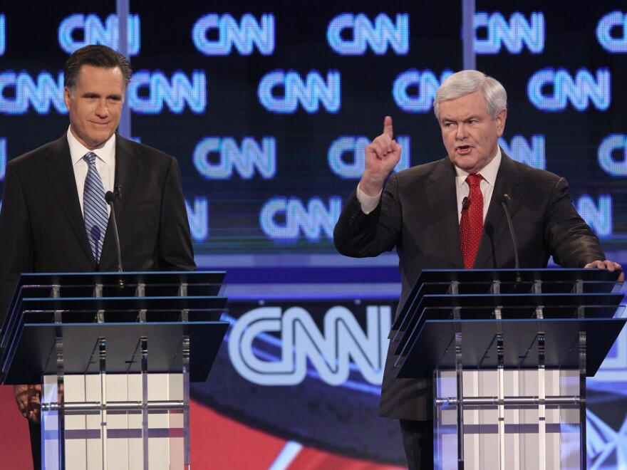 Newt Gingrich (right) responds to a question about things one of his ex-wives said about their marriage during last night's debate in South Carolina. Mitt Romney, looks on.