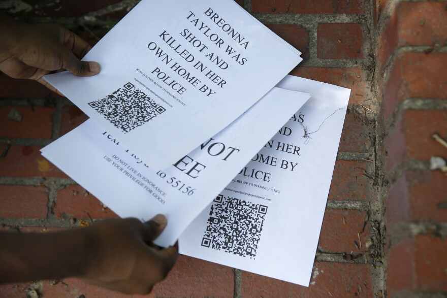 Amiri Nash's signs have QR codes with resources, including a link to donate to the Black Lives Matter movement.