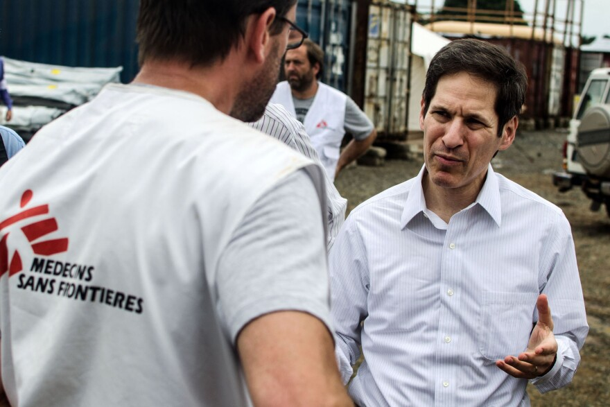 Dr. Tom Frieden, director of the CDC, talks with staff from Doctors Without Borders during a visit to the nonprofit group's newest Ebola treatment center in Monrovia, Liberia.