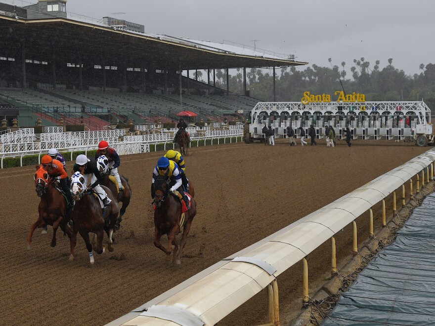 Horses run in the fourth race at Santa Anita Park in front of empty stands, Saturday, March 14 in Arcadia, Calif. Racing at the facility has been suspended since March 27 because of the coronavirus.
