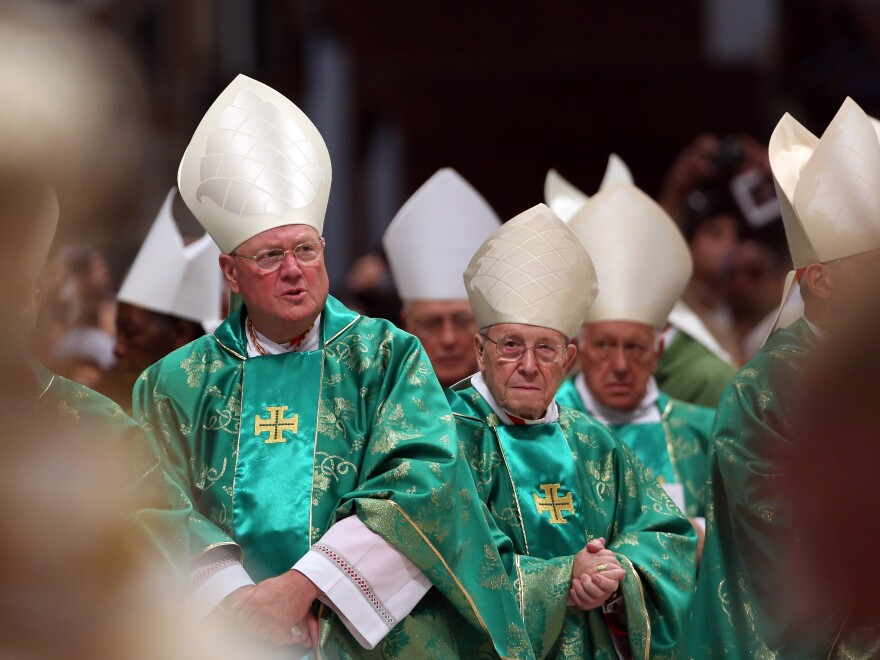 Archbisop of New York Cardinal Timothy Dolan (left) attends the Opening Mass of the Synod of Bishops celebrated by Pope Francis in St. Peter's Basilica on Sunday in Vatican City. The two-week conference will discuss family issues, including controversial topics like divorce and contraception.