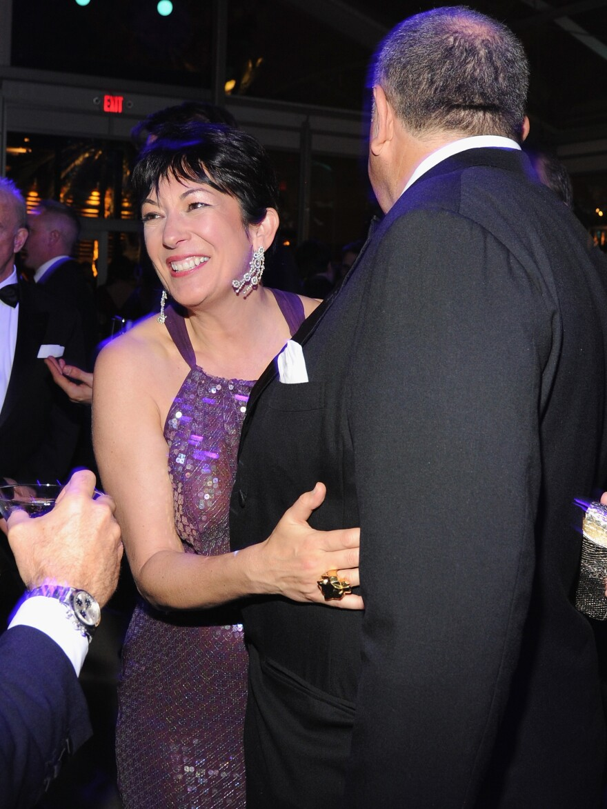 Ghislaine Maxwell and a guest at the 2014 <em>Vanity Fair</em> Oscar party hosted by Graydon Carter in West Hollywood, Calif.