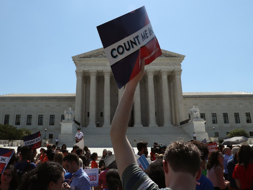 Demonstrators against the now-blocked census citizenship question gather in front of the U.S. Supreme Court in June 2019 in Washington, D.C. A federal judge in New York ruled Thursday to penalize the Trump administration for failing to disclose documents before going to trial over the question.