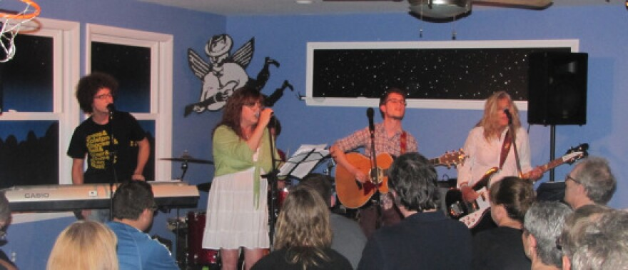 Susan Cowsill and her band at a house concert.