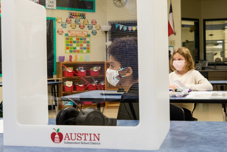 Students wear masks in class at Boone Elementary School last month.