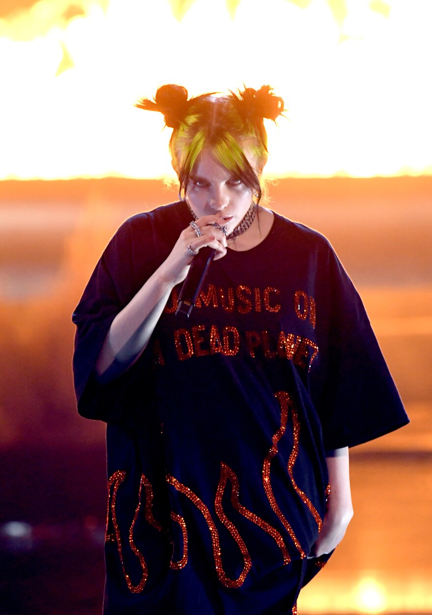 """Billie Eilish performs at the American Music Awards in November. Eilish's music speaks for weird kids in the same way most of teen pop has spoken for idealized """"normal"""" ones."""