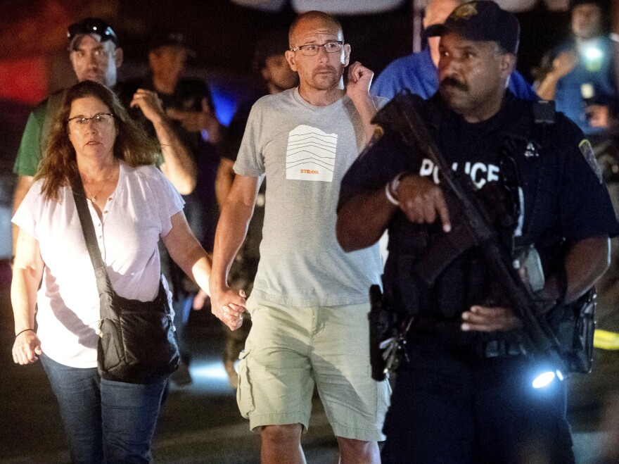 Police officers escort people from Christmas Hill Park following a deadly shooting during the Gilroy Garlic Festival in Gilroy, Calif., on Sunday.