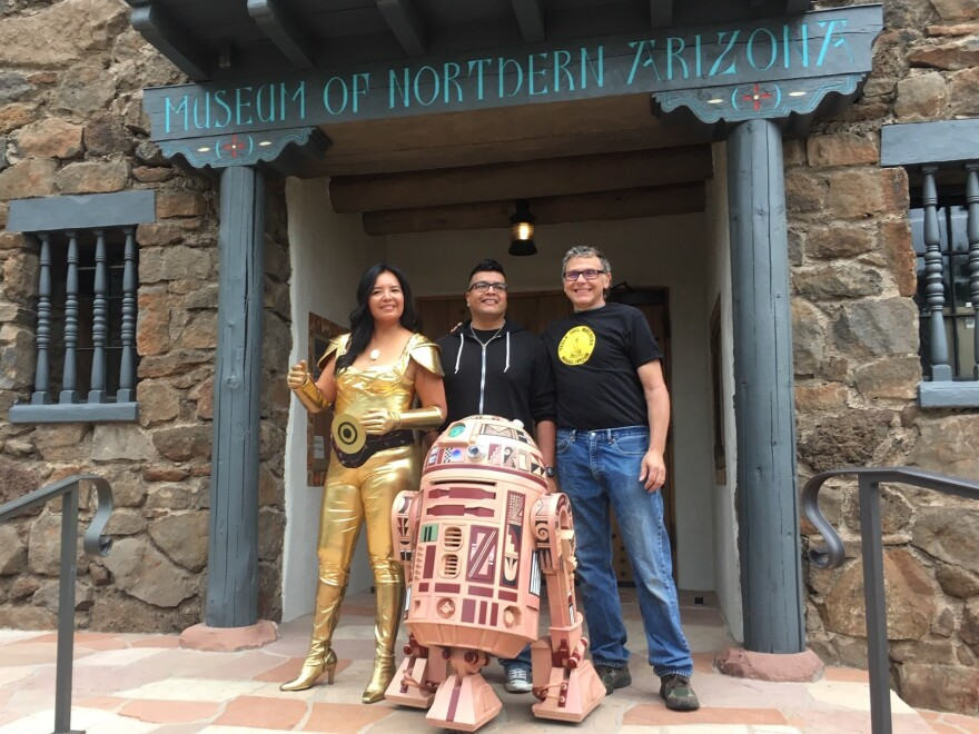 Geri Hongeva (left), who voiced C-3PO in the Navajo translation of <em>A New Hope</em>; artist Duane Koyawena (center); and engineer Joe Mastroianni with Hopi R2 at the Museum of Northern Arizona in Flagstaff.