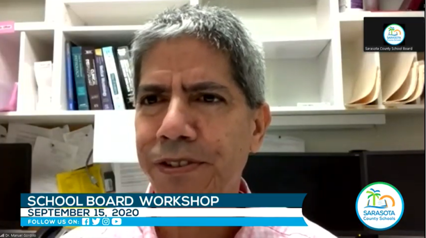 Manuel Gordillo talks to the board via Zoom from his office