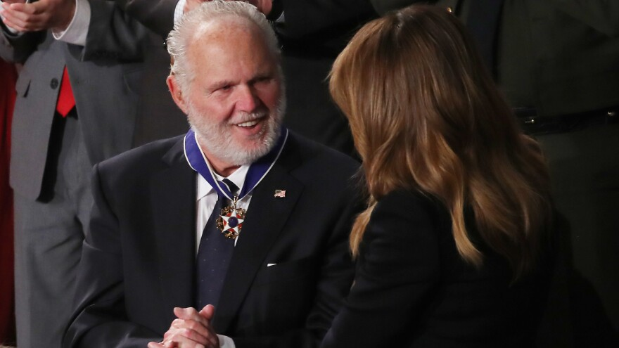 Rush Limbaugh says he intends to keep putting on his radio show despite his stage four lung cancer that he says has recently progressed. Here, he's seen reacting as First Lady Melania Trump gives him the Presidential Medal of Freedom during the State of the Union address in February.
