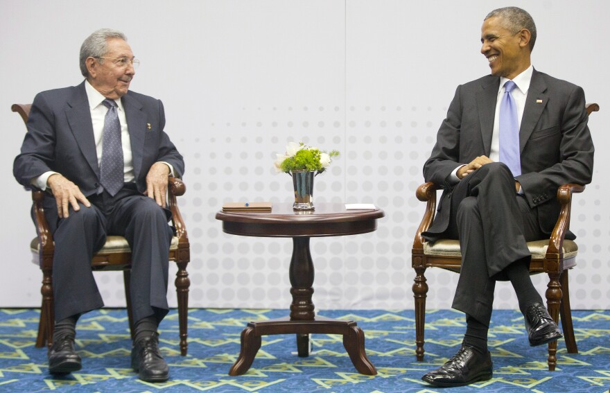 President Barack Obama smiles as he looks over towards Cuban President Raul Castro during their meeting at the Summit of the Americas in Panama City, Panama on Saturday.