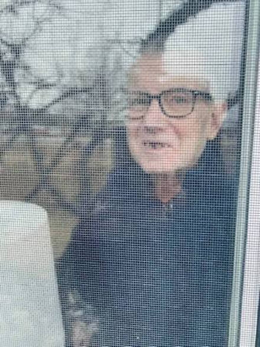 Cass Sullivan snapped a photo of her father, Pat, seen through the window of his room at a senior-living facility in Billings, when she visited him last week, and later posted it on Facebook.