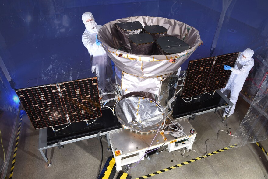 Technicians help prepare the spacecraft for its mission. TESS is the next step in the search for planets outside of our solar system, including those that could support life.