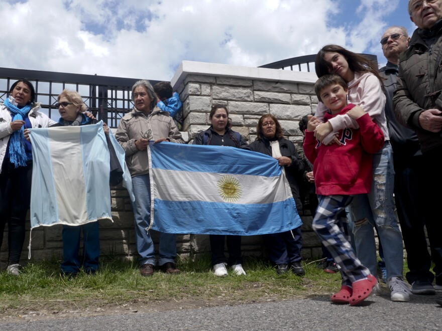 People gather outside the naval base in Mar del Plata, Argentina, on Monday, hoping for word on 44 crew members aboard the missing submarine ARA San Juan.