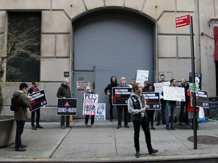 In a Manhattan demonstration this spring, members of ACT UP protest drug company lobbying of elected officials. The AIDS activists see Truvada's high price as another example of profiteering by some makers of prescription drugs.