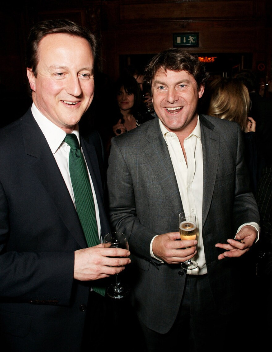 In this photo from 2009, David Cameron (left) attends a book launch for Charlie Brooks in London. Cameron, who has since become Britain's prime minister, went to Eton with Brooks, husband of Rebekah Brooks, the former News International executive toppled by Britain's phone-hacking scandal. The latest twist in that scandal involves Rebekah Brooks, Cameron and a retired police horse.