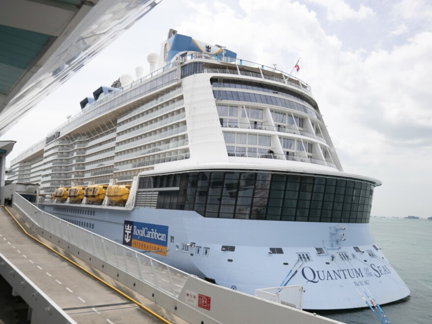 "Royal Caribbean said in a statement that a guest on the Quantum of the Seas, shown here on Wednesday, ""tested positive for coronavirus after checking in with our medical team."" The ship returned to port in accordance with government protocols."