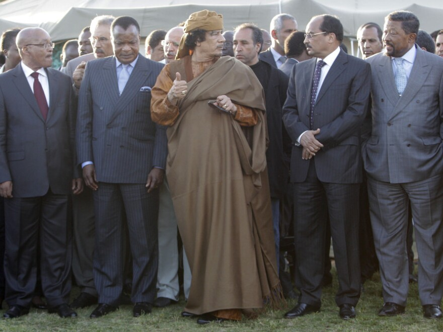 Libyan leader Moammar Gadhafi, center, and leaders from other nations in the African Union, Sunday in Libya.