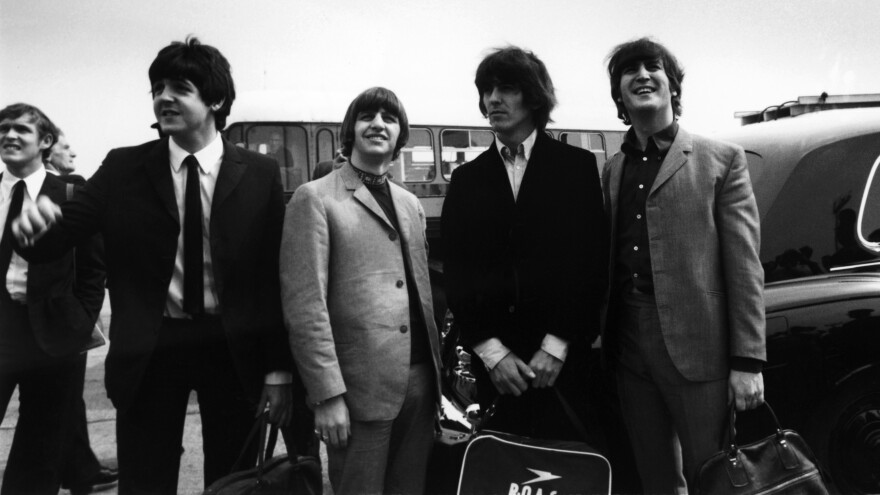 Paul McCartney, Ringo Starr, George Harrison and John Lennon prepare to take off for a U.S. tour on Aug. 13, 1965. Fourteen days later, they'd find themselves in a much-anticipated but very awkward meeting with Elvis Presley.