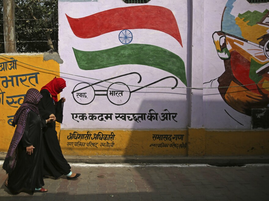 Muslim women leave a polling station after casting their votes in Khatauli, Uttar Pradesh, India, on Thursday. Uttar Pradesh, India's most populous state, is led by a Hindu priest and has banned the consumption of beef and changed some city names to reflect Hindu heritage.