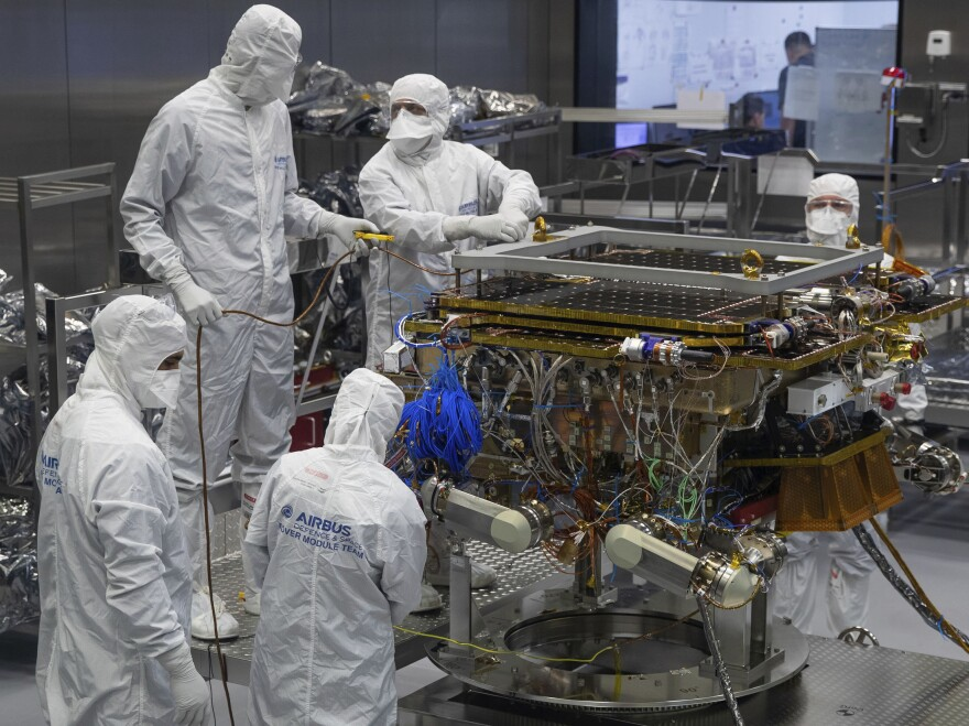 A team prepares the European Space Agency's ExoMars rover to leave the Airbus plant in Stevenage, England in August.