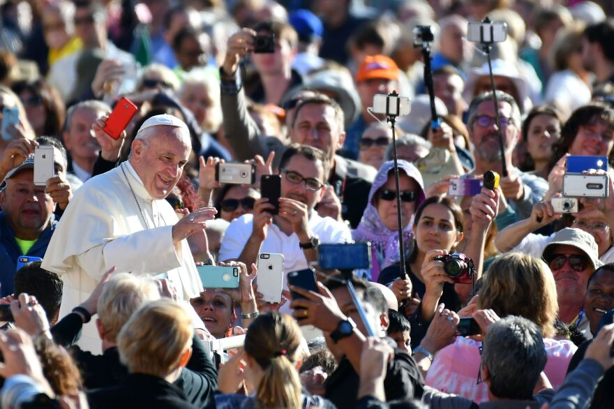 In his weekly audience, Pope Francis called for followers to put down their cellphones during Mass, and be more engaged in the Eucharist. The pontiff is pictured here arriving in the Vatican's St. Peter's Square last year.
