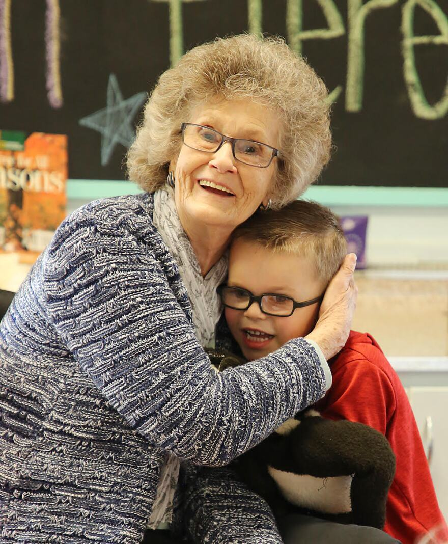 "Kayden Ferreira, 5, pauses to give ""Grandma"" Pearl Hawkins a hug Friday, Jan. 10, 2020."