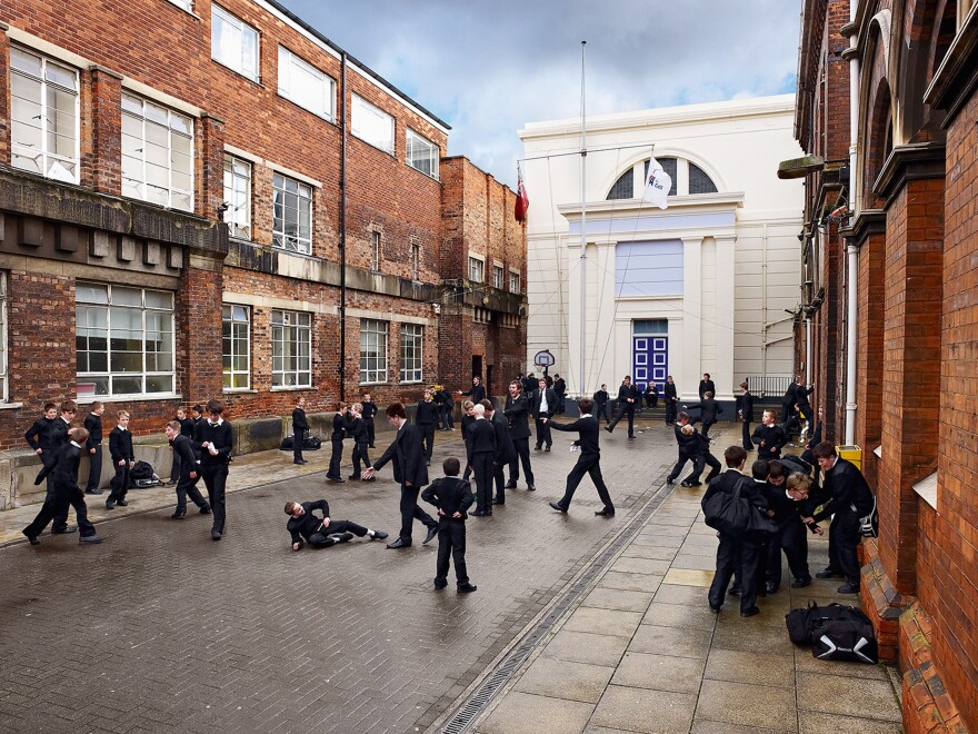 Teens take a break on a courtyard between classes at Hull Trinity House Academy, an all-boys school in the U.K.