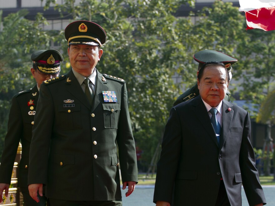 China's Defense Minister Chang Wanquan, left, and Thailand's Defense Minister Prawit Wongsuwan walk during a ceremony at the Ministry of Defense in Bangkok, Thailand on Friday.