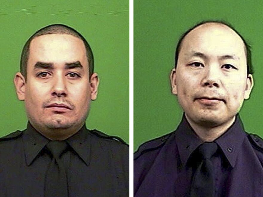 Officer Rafael Ramos (left) and Wenjian Liu were killed on Saturday in an attack by a gunman in a Brooklyn neighborhood.