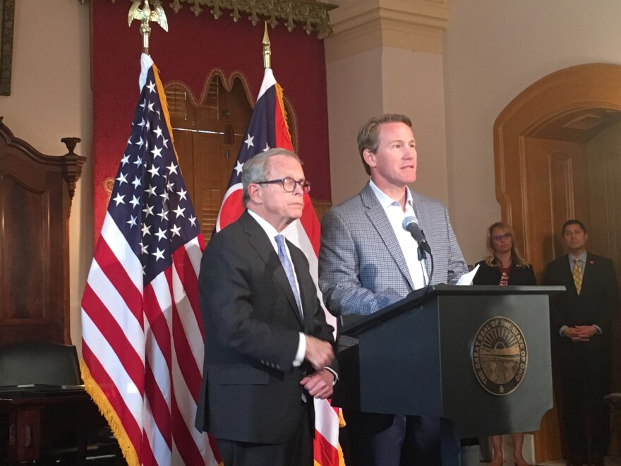 a photo of Mike DeWine and Jon Husted
