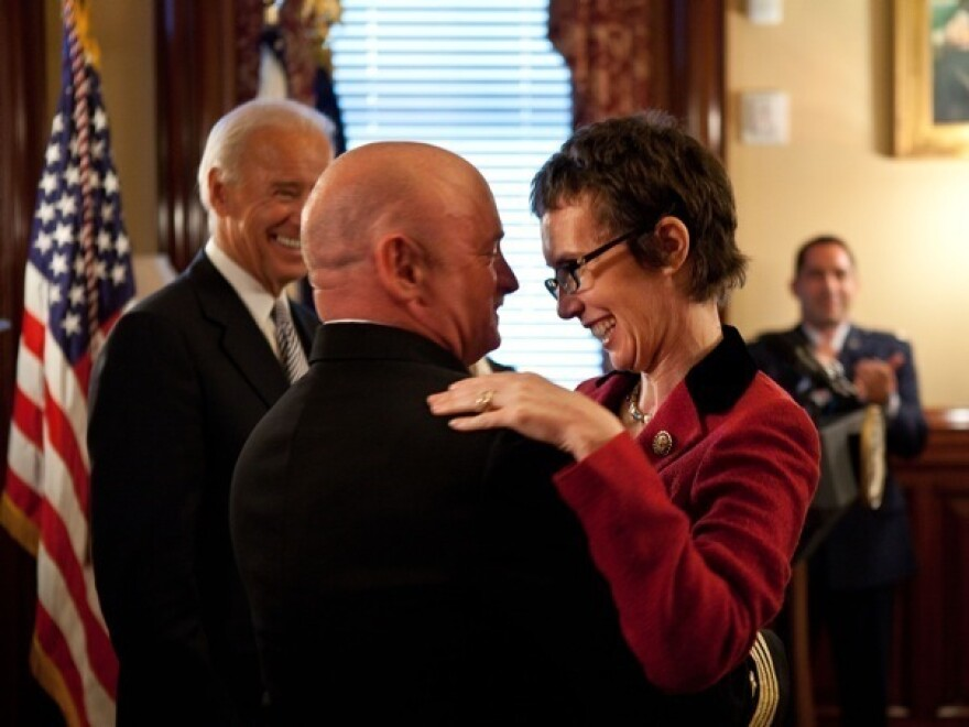 Captain Mark Kelly hugs his wife, Congresswoman Gabrielle Giffords at the White House in October.