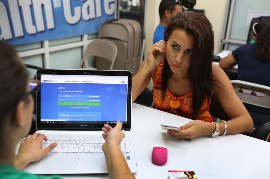 Alina Nurieva (right) sat with Gabriela Cisneros, an insurance agent from Sunshine Life and Health Advisors, and picked an insurance plan at the Mall of the Americas in Miami last November.