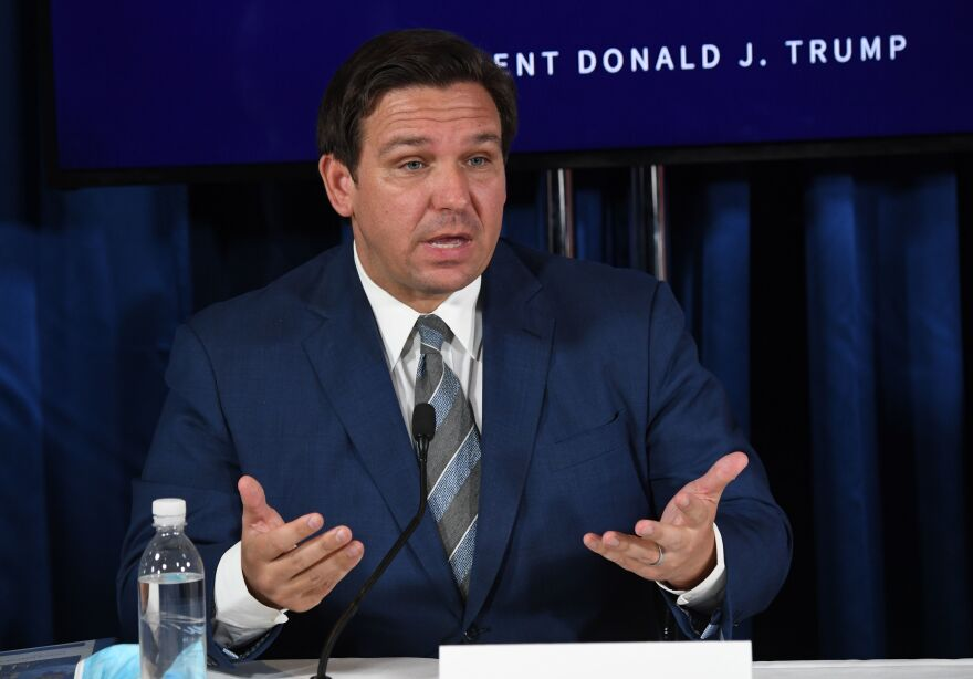 Florida Gov. Ron DeSantis, seen here in July, has extended the voter registration deadline by a day after the state's online portal crashed Monday.