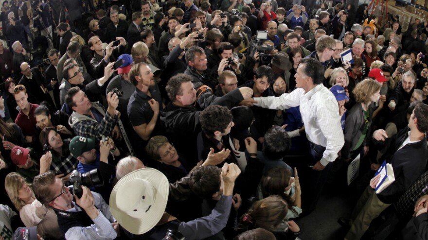 Republican presidential candidate Mitt Romney greets a crowd during a campaign stop on Monday.