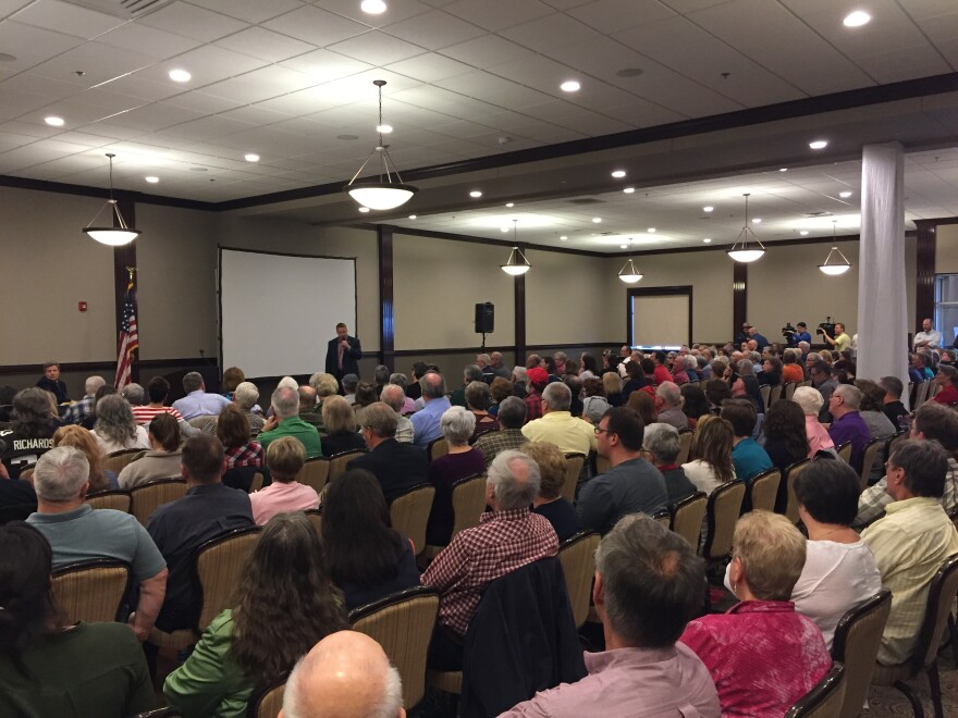 More than 200 people crowded into a town hall meeting with Republican 8th district Congressman Warren Davidson Tuesday night in Troy.