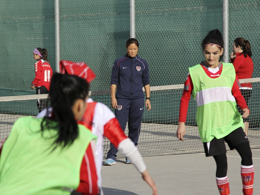 Former U.S. Olympic soccer player Lorrie Fair (in blue sweats) holds a recent clinic for the Afghan women's soccer team at the U.S. Embassy in Kabul.
