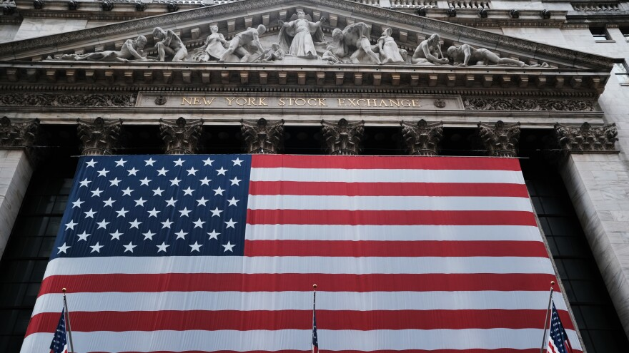 Stocks fell again Monday as U.S. lawmakers continued to work on a massive stimulus measure. The floor of the New York Stock Exchange was closed as the exchange shifted to all-electronic trading amid the coronavirus outbreak.