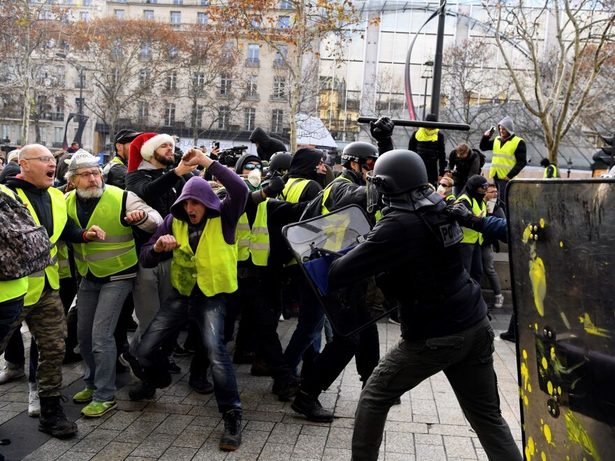 Yellow vest protesters face off against police in Paris on Saturday.