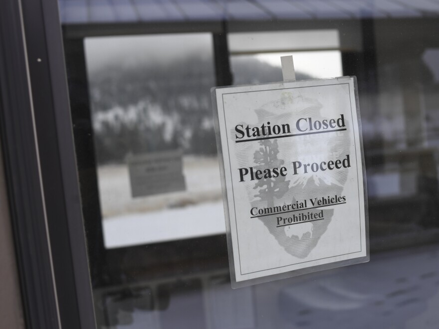 A pay station at Rocky Mountain National Park is closed on Thursday in Estes Park, Colo. Many parks remain open but unstaffed during the partial shutdown of the federal government.