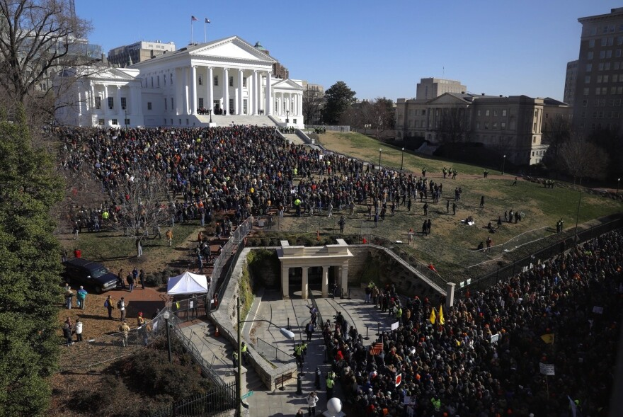 The rally featured a slate of speeches before those gathered on the lawn below the Capitol.