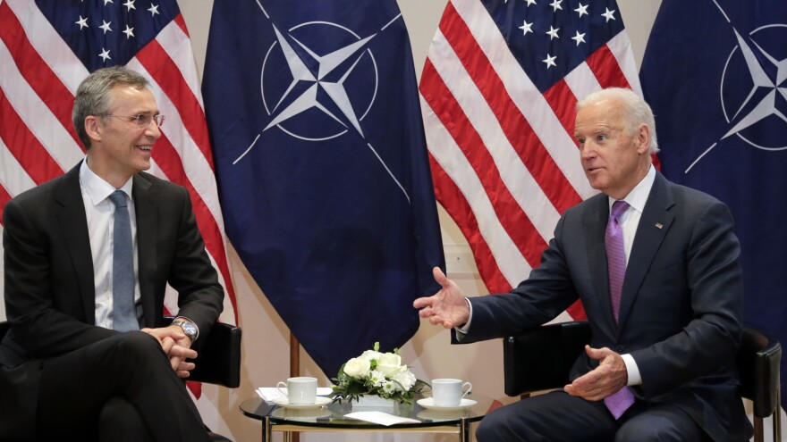 Then-Vice President Biden (right) gestures next to NATO Secretary-General Jens Stoltenberg during a meeting in Munich, Germany, Feb. 7, 2015.