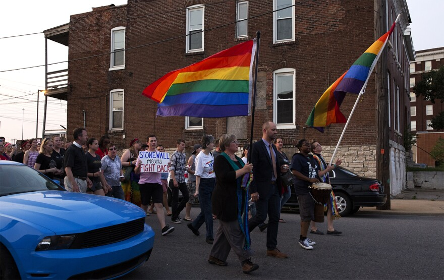 Hundreds march from Manchester Avenue and Sarah Street to the Transgender Memorial Garden on Vandeventer Avenue.