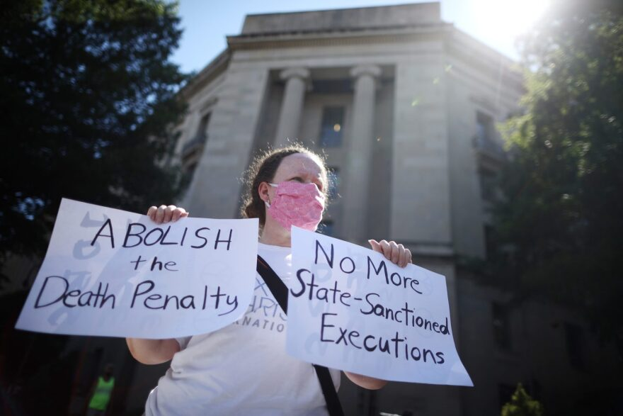 An anti-death penalty activist demonstrates in front of the U.S. Justice Department's Robert F. Kennedy Building in Washington, DC.