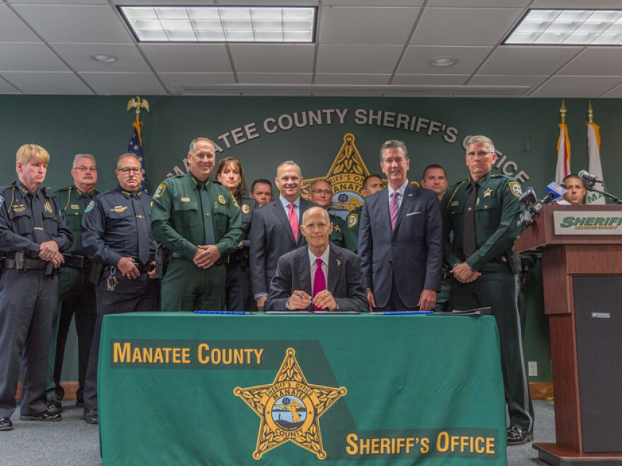 Gov. Rick Scott signed the bill on Monday in Manatee County, which saw Florida's highest number of deaths from fentanyl analogs in 2016.