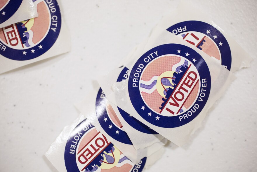 St. Louis voting stickers are seen on a table at Central Baptist Church in St. Louis on March 10, 2020.