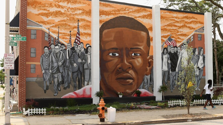 A mural memorializing Baltimore resident Freddie Gray adorns a wall near the place where he was tackled and arrested by police.