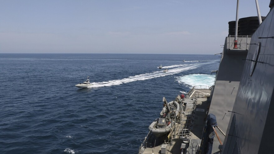 Iran's Islamic Revolutionary Guard Corps vessels approach U.S. military ships in the Persian Gulf near Kuwait on Wednesday.