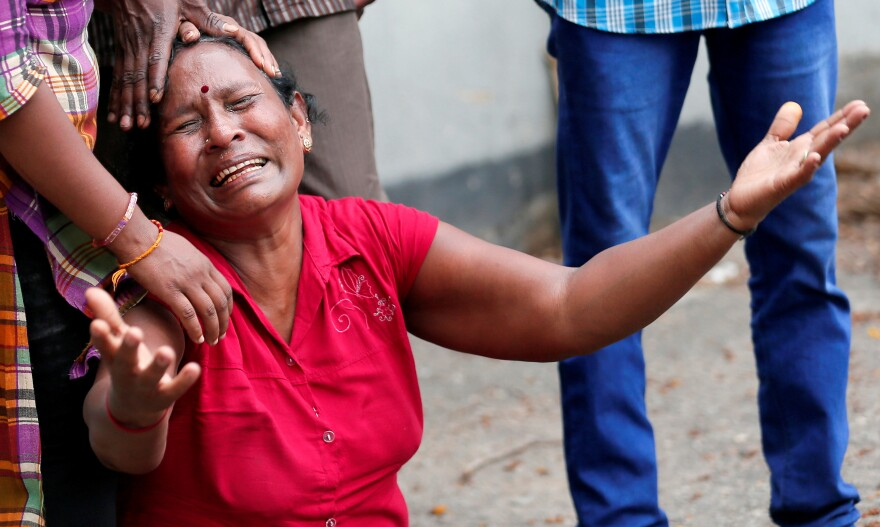 A relative of a victim of the explosion at St. Anthony's Shrine in Colombo grieves at the police mortuary.